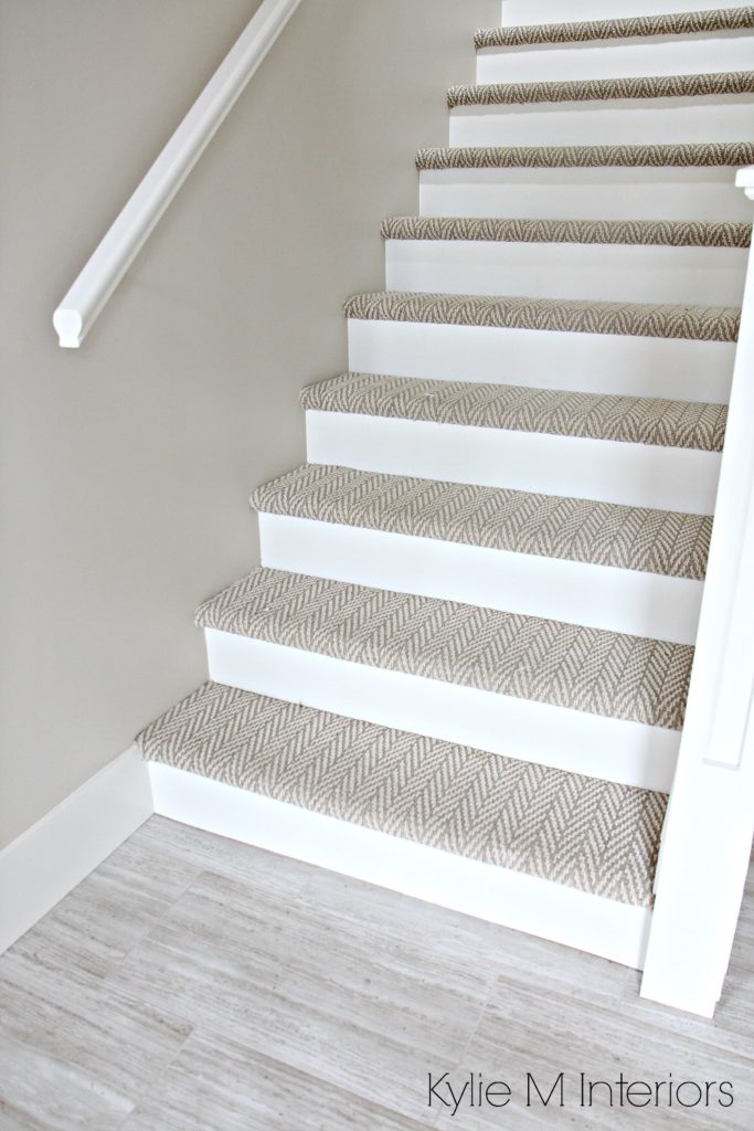 Stairs with carpet herringbone treads and painted white