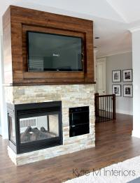 Stone ledgestone 3 sided fireplace with wood shiplap that ...