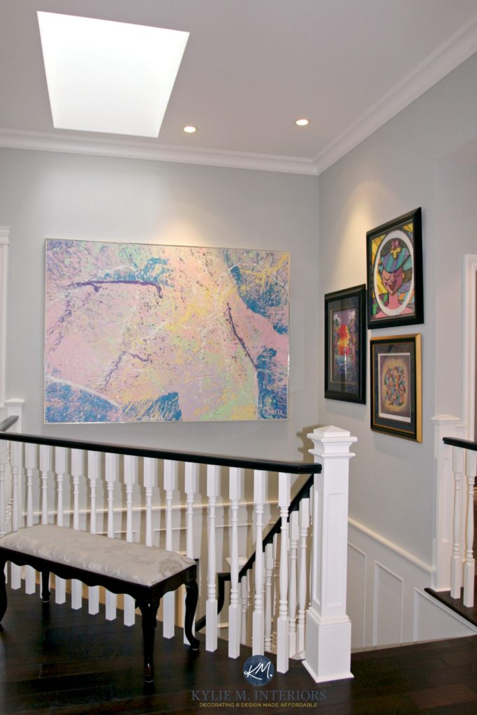 Benjamin Moore Stonington Gray in a stairwell with black hand rail and white spindles and