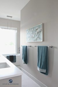 Bathroom with marble floor, teal accents, freestanding tub ...