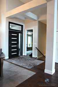 Contemporary modern front door painted black with beams ...