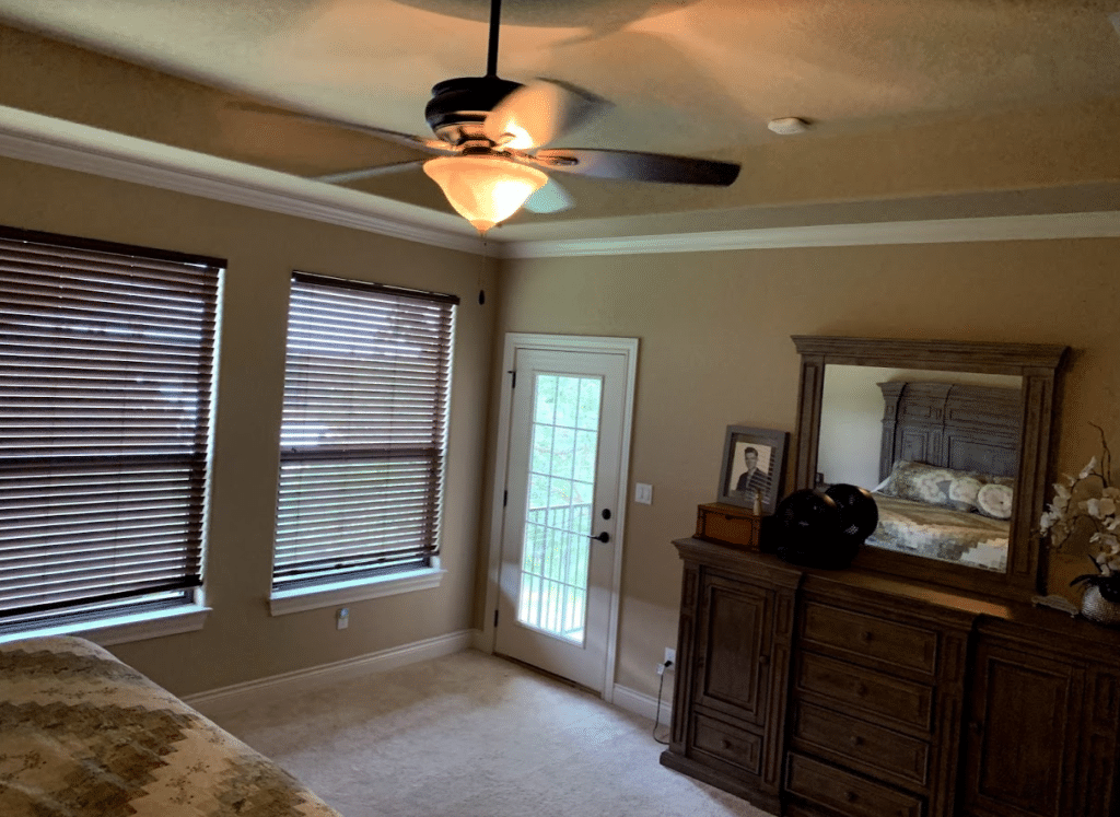 Bedroom before being painted wood furniture beige carpet