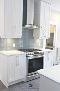 White shaker style cabinets, white quartz countertops ...