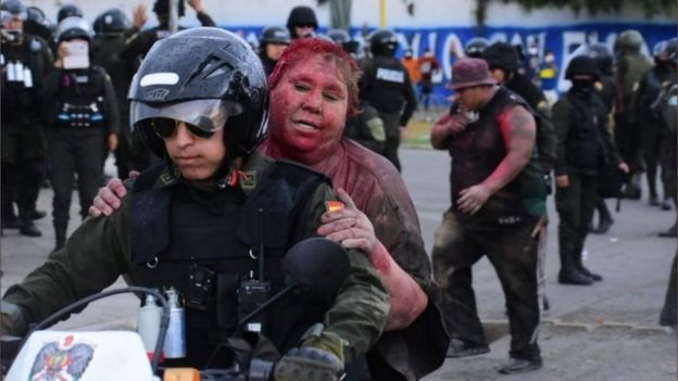 The-mayor-of-a-small-town-in-Bolivia-has-been-attacked-by-opposition-protesters-who-dragged-her-through-the-streets-barefoot-covered-her-in-red-paint-and-forcibly-cut-her-hair..jpg