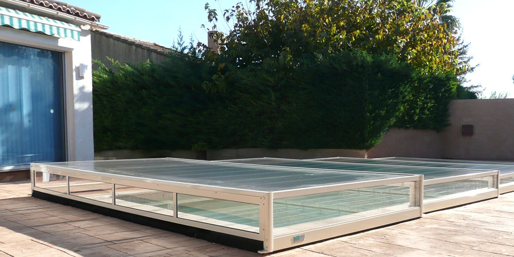 Aladdin piscine gallery of with aladdin piscine cheap for Abri de piscine sans rail au sol