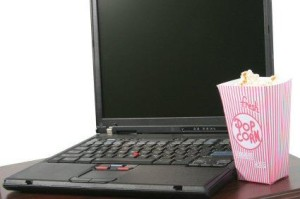 a laptop and popcorn