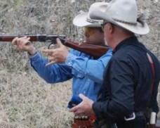 2 men holding gun