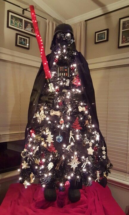 Unique Star Wars / Darth Vader Christmas Tree | Want ideas for unique Christmas trees for the 2020 holiday season? Find inspiration ideas for your Christmas tree decoration from creative and unique xmas trees. From white, upside down, best Christmas trees on wall, pink Christmas trees, and even Disney Christmas tree decorations. From big and small unique Christmas tree ideas. Perfect for kids and for the holidays. #uniquechristmastree #christmastreeideas #christmastreeideas #christmas