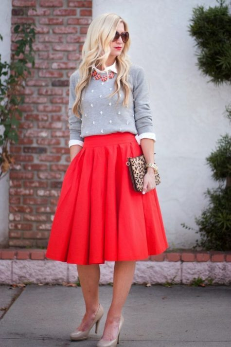 woman wearing an Elegant Red Midi Skirt with Grey Sweater