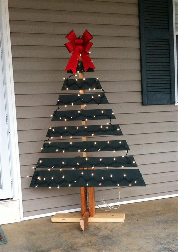 A Cute DIY Christmas Tree | Want ideas for unique Christmas trees for the 2020 holiday season? Find inspiration ideas for your Christmas tree decoration from creative and unique xmas trees. From white, upside down, best Christmas trees on wall, pink Christmas trees, and even Disney Christmas tree decorations. From big and small unique Christmas tree ideas. Perfect for kids and for the holidays. #uniquechristmastree #christmastreeideas #christmastreeideas #christmas