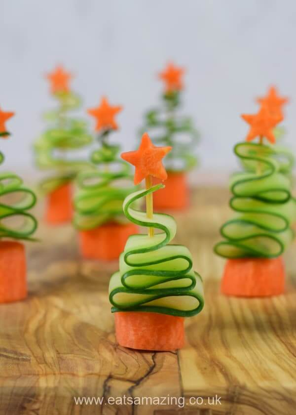 Cucumber Christmas Trees | Want to serve your guests the best Christmas party appetizers this year? Find a list of 40+ Christmas appetizers ideas & easy recipes for Christmas party appetizers, both sweet and savory holiday food. From elegant Christmas finger food ideas to easy dips, and simple crockpot holiday appetizers, (vegetarian, keto and even gluten-free appetizer ideas), perfect for a crowd and for kids. #christmaspartyappetizers #appetizersforchristmasparty #christmasparty #fingerfood #christmasfood