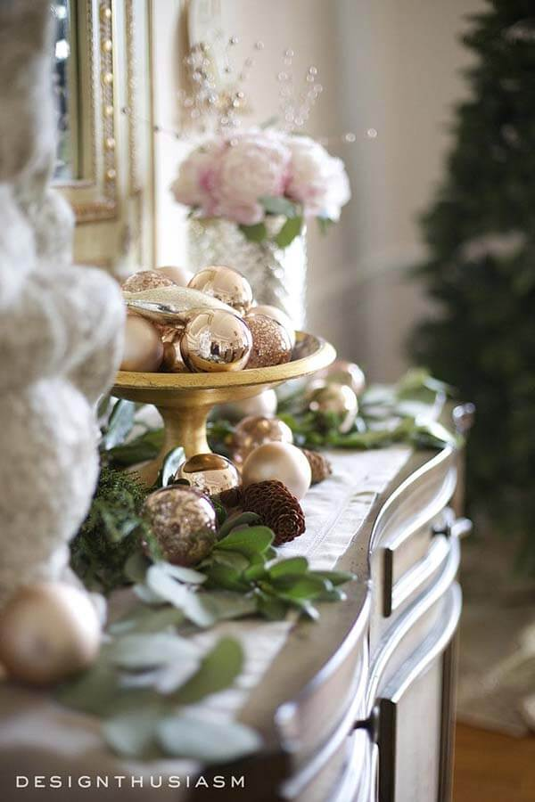 Gold Bowl with Pink Gold Balls | Want ideas for a themed Christmas decor this year? There is nothing more elegant and feminine that pink gold decor and the sky is the limit when looking for pink gold Christmas decoration. From pink Christmas tree, elegant gold pink Christmas decoration and ornaments, gold pink xmas wreaths, gold pink ideas DIY and the cutest gold pink Christmas decor from the dollar store. #pinkchristmas #pinkgoldchristmas #pinkchristmasdecor #pinkchristmasaesthetic #themedchirstmas