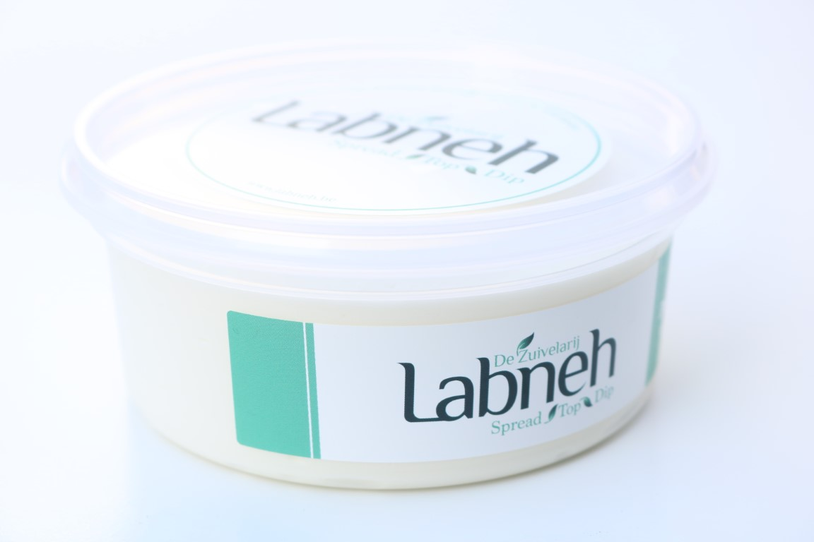 Labneh, strained yogurt in elegant packaging, on a white background.