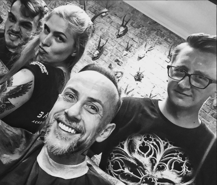 """Barberian Academy Barber posing with """"O Tempus Edax"""" t-shirt together with the crew and Nergal from Behemoth"""