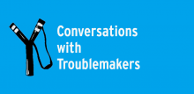 """Black slingshot on blue background with text """"Conversations with Troublemakers"""""""