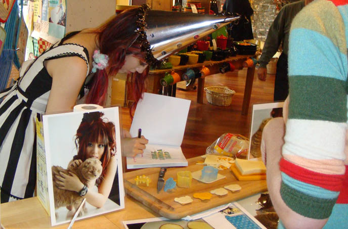 Japanese bento decoration book, CUTE BENTO BOX LUNCH DEMO VIDEO. LIVE COOKING CHARABEN TUTORIAL AT NEW YORK BOOK SIGNING, JAPANESE BENTOS LESSON, KID'S RECIPES COOKBOOK, charaben, best kid's cooking, fun quirky j-pop culture books, clown pierrot pointy silver hat, striped black and white costume Halloween.
