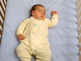 CAP Baby In crib on back