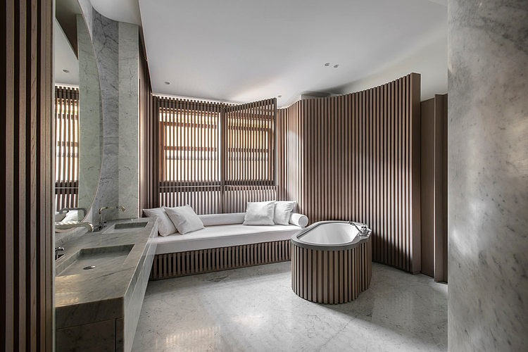 Oak and marble bathroom.