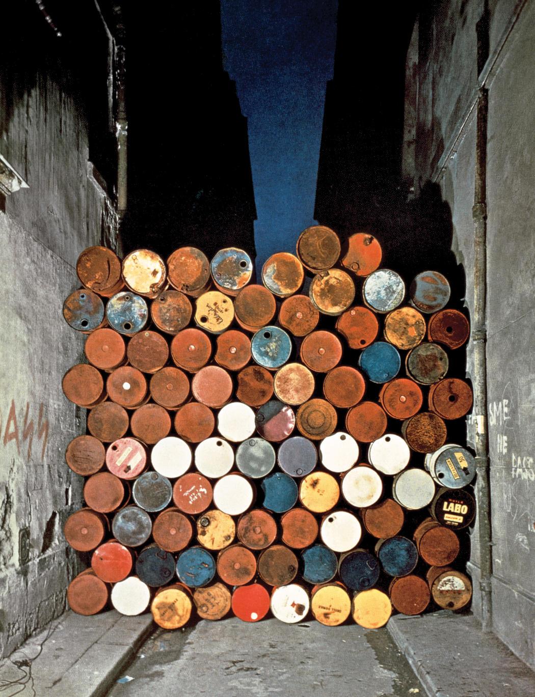 Christo and Jeanne-Claude  Wall of Oil Barrels - The Iron Curtain, Rue Visconti, Paris, 1961-62  Photo: Jean-Dominique Lajoux  © 1962 Christo