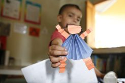 boy holding artwork