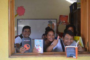 children holding books