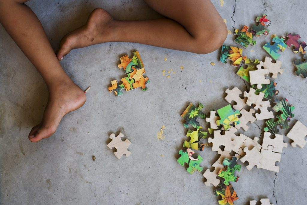 child with jig-saw puzzle