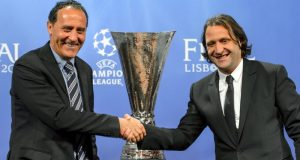 Valencia CF club ambassador Francisco Rufete (R) and Sevilla FC club ambassador Francisco Lopez Alfaro shake hands during the draw for the semi-finals of the football UEFA Europa League at the UEFA headquarters in Nyon on April 11, 2014. Spain is guaranteed a place in the Europa League final after Sevilla and Valencia were drawn against each other in Friday's draw for the semi-finals. The winner will play Benfica of Portugal or Juventus of Italy, who will dispute the second semi-final. AFP PHOTO / FABRICE COFFRINI (Photo credit should read FABRICE COFFRINI/AFP via Getty Images)