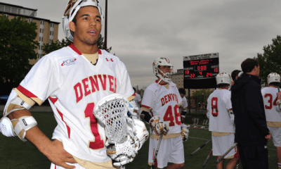 May 15, 2011; Denver, CO, USA; Denver Pioneers midfielder Cameron Flint (18) stands and reacts as fans and teammates celebrate the victory over the Villanova Wildcats during the first round of 2011 NCAA mens lacrosse tournament at Peter Barton Lacrosse Stadium. Denver defeated Villanova, 13-10. Mandatory Credit: Andrew Fielding-US PRESSWIRE