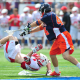 May 21, 2011; Hempstead NY, USA; Virginia Cavaliers midfielder Chris LaPierre (44) flips Cornell Big Red defenseman Mike Bronzino (31) during the quarterfinal round of 2011 NCAA mens lacrosse tournament at James M. Shuart Stadium. Virginia defeated Cornell by a score of 13-9. Mandatory Credit: Andrew Fielding-US PRESSWIRE