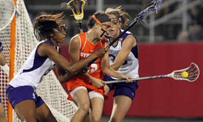 May 27, 2012; Stony Brook NY, USA; Northwestern Wildcats m/d Taylor Thornton (9) and Northwestern Wildcats midfielder Alexa deLyra (25) box out Syracuse Orange attack Michelle Tumolo (35) during the first half of the 2012 NCAA Division 1 Womens Lacrosse Championship at LaValle Stadium. Mandatory Credit: Anthony Gruppuso-US PRESSWIRE