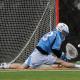 Mar 2, 2012; Princeton, NJ, USA; John Hopkins Blue Jays goalie Pierce Bassett (33) makes save against the Princeton Tigers at Princeton. Mandatory Credit: Jim O'Connor-US PRESSWIRE