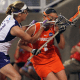 May 27, 2012; Stony Brook NY, USA; Syracuse Orange attack Alyssa Murray (1) takes a stick to the face by Northwestern Wildcats midfielder/attack Alex Frank (11) during the first half of the 2012 NCAA Division 1 Womens Lacrosse Championship at LaValle Stadium. Mandatory Credit: Anthony Gruppuso-USA TODAY Sports