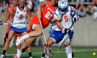 May 25, 2012; Stony Brook NY, USA; Syracuse Orange midfielder/attack Gabby Jaquith (20) loses the ball as Florida Gators goalie Mikey Meagher (5) defends the net during the first half of the 2012 NCAA Division 1 Womens Lacrosse Semifinals at LaValle Stadium. Syracuse won 14-13 in overtime. Mandatory Credit: Anthony Gruppuso-USA TODAY Sports