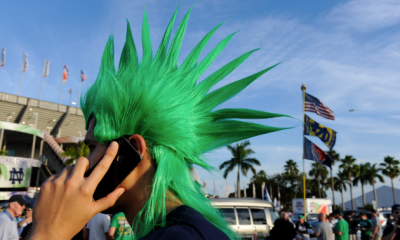 Jan 7, 2013; Miami, FL, USA; Notre Dame fan Juan Gutierrez on a cell phone during tailgating outside the stadium prior to the start of 2013 BCS Championship game between Notre Dame Fighting Irish and the Alabama Crimson Tide at Sun Life Stadium. Mandatory Credit: Eileen Blass-USA TODAY Sports
