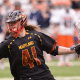 Feb 22, 2014; Syracuse, NY, USA; Maryland Terrapins attackman Colin Heacock (41) runs past Syracuse Orange defenseman Brandon Mullins (11) during the fourth quarter of a game at the Carrier Dome. Maryland won the game 16-8. Mandatory Credit: Mark Konezny-USA TODAY Sports