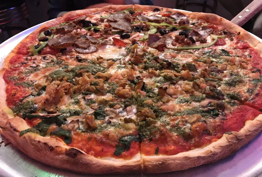 Large Neapolitan (Thin Crust) pizza, half Veggie II and half Village Special at Village Pizzeria