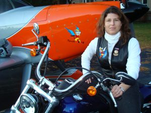 Kelly with her RV-8 and motorcycle