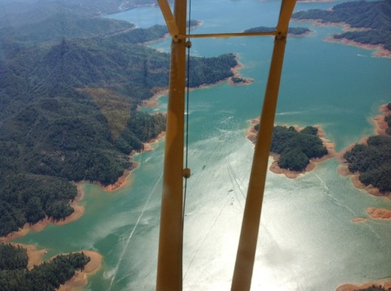 Over Lake Shasta, flight of five Cubs flying from Independence, Oregon to the West Coast Cub Fly-in at Lompoc, California.