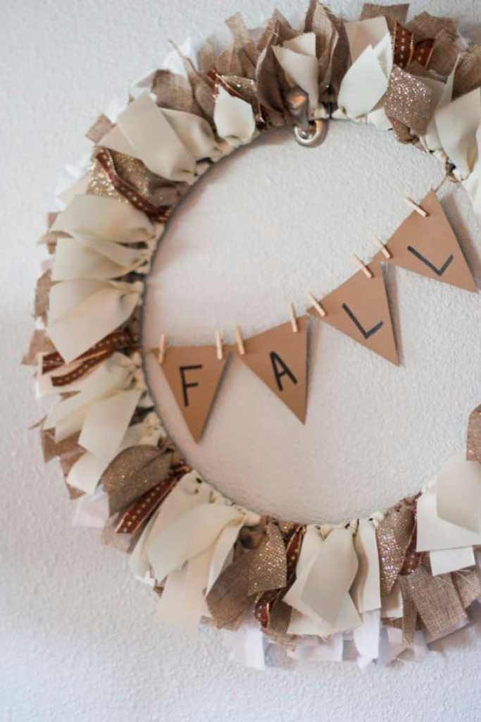 Neutral DIY Fall Ribbon Wreath. This is the best DIY Fal decorating ideas for the porch. Outdoor Fall Decorating ideas for your porch and beyond. Easy fall decorating ideas for your front porch. Lots of simple and inexpensive ideas to help you decorate your home for fall. #falldecor #falldecorations #fallonabudget #homedecorideas