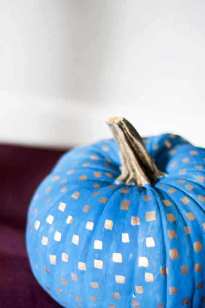 Check out these painted pumpkins you can use to decorate your home this fall on a budget? It's amazing what you can do the decorate a standard orange pumpkin. Love the metallic pattern detail!