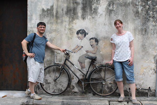 Kids on bicycle Penang street art