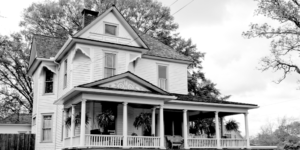 A black and white photo of the farm house that was the beginnings of what is now known as Lad Lake