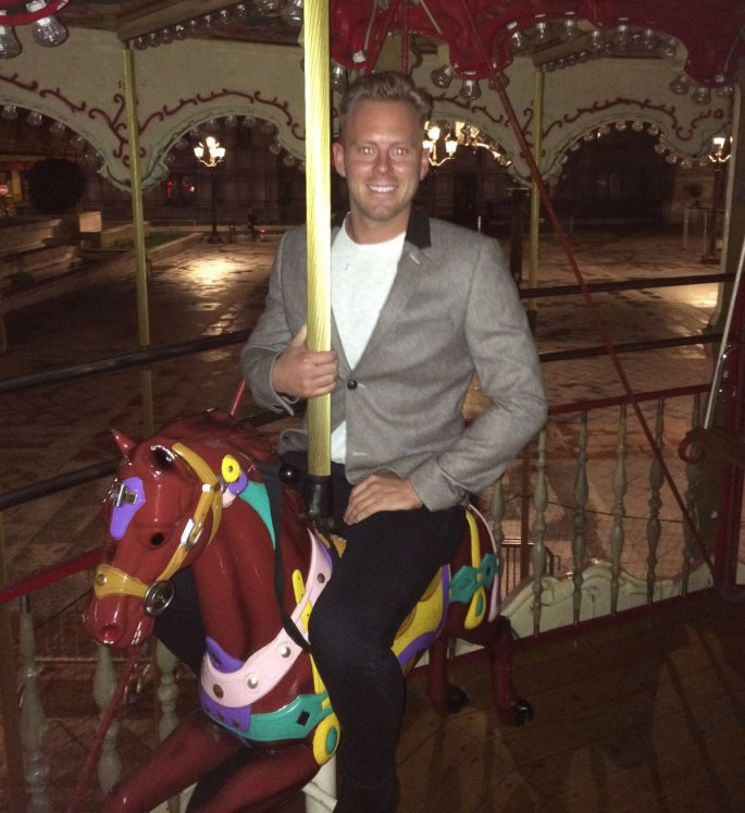 Lee on a merry go round