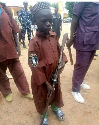 Nigerians reacts as 10-year old boy acts as vigilante, carries a gun