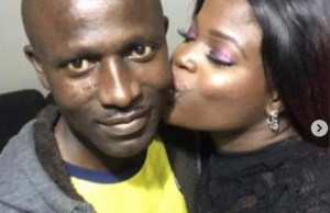 Freed officer reunites with wife, as she happyly kisses him