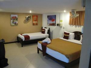 Rich Resort Beachside Hotel bedoom
