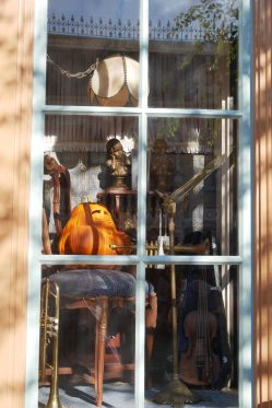 Trumpet playing pumpkin in window at 20th Century Music Company | Photo credit: Krista