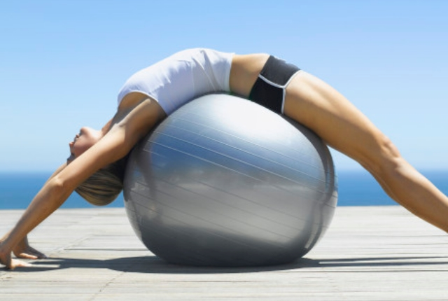 Bending Over Ball Stretch