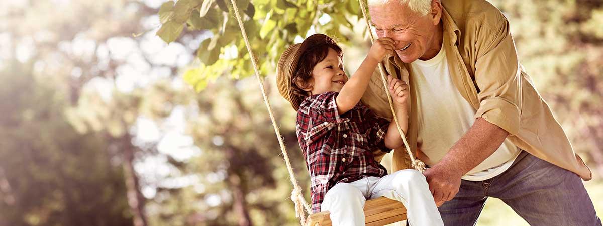 Grandfather pushing on swing