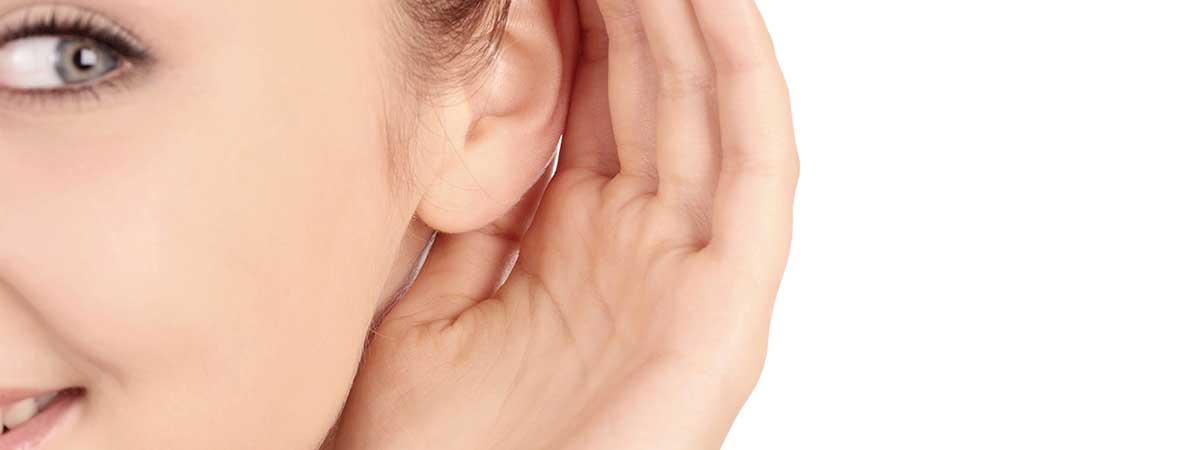 Girl cupping ear
